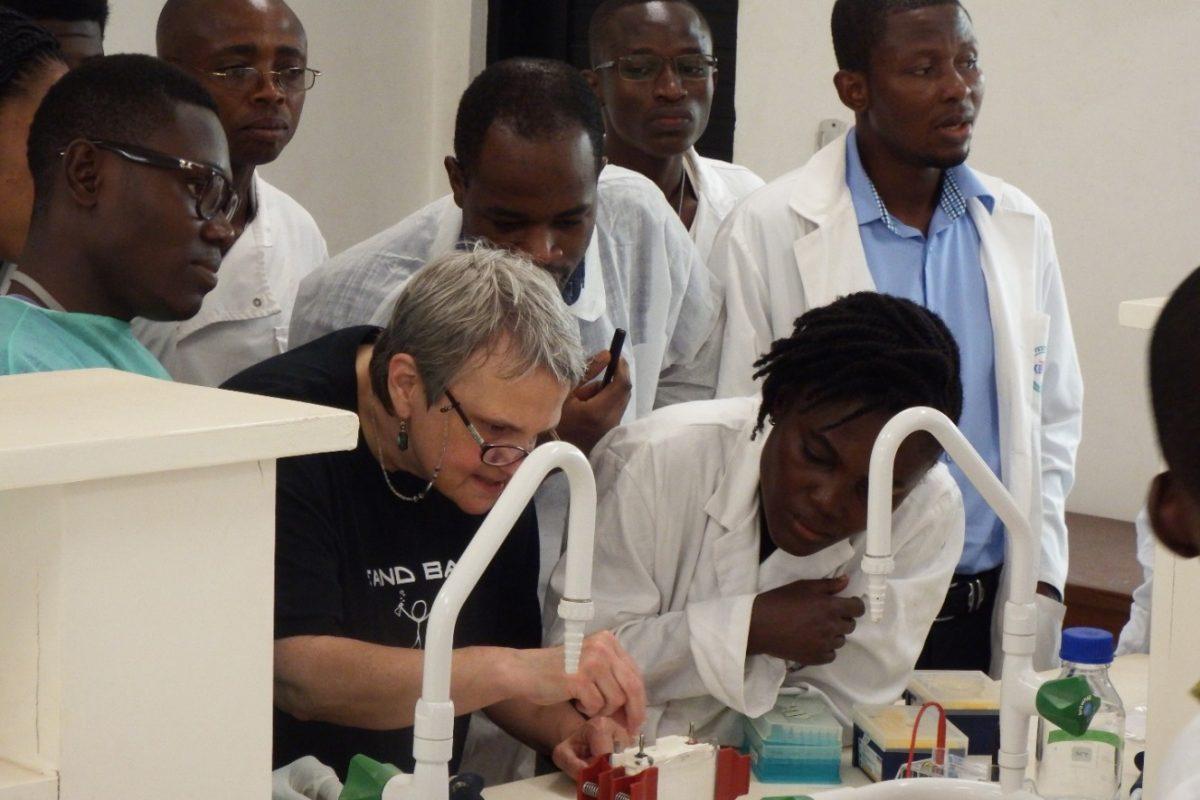 Joy Power demonstrating a laboratory technique to course participants