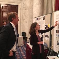 Sen. Jeff Flake listens as Duke biologist Sheila Patek explains her research Wednesday on ultra-fast mechanics in shrimp. FASCB photo by Lynn Marquis
