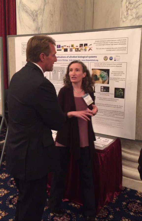 Jeff Flake (R-AZ) listens as Sheila Patek (Duke) explains her research.