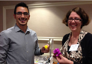 Enrique Daza, a PhD candidate at the University of Illinois Urbana-Champaign, and Courtney Young, a PhD candidate at the University of California, Los Angeles, show off their 3D printer project medical devices.